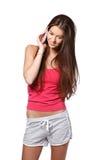 Mujer joven agradable que hace una llamada Fotografía de archivo
