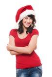 Mujer joven alegre en el sombrero de santa rojo Imagen de archivo libre de regalías