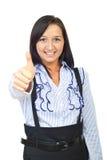 Mujer joven alegre que da los pulgares Imagen de archivo libre de regalías