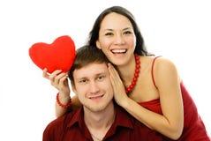 Mujer joven alegre y su marido Imagen de archivo