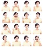 Mujer joven asiática que hace diversas expresiones faciales Imágenes de archivo libres de regalías