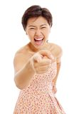Mujer joven asiática que precisa y que ríe Fotografía de archivo
