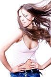 Mujer joven atractiva con el pelo largo soplado fotos de archivo libres de regalías
