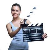Mujer joven atractiva con la chapaleta de la película Foto de archivo libre de regalías