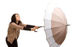 Mujer joven atractiva con un paraguas Imágenes de archivo libres de regalías
