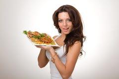 Mujer joven atractiva con una comida Fotografía de archivo libre de regalías