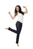 Mujer joven atractiva en pantalones vaqueros. Imagen de archivo libre de regalías