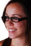 Mujer joven atractiva en vidrios Imágenes de archivo libres de regalías