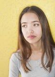 Mujer joven atractiva multirracial que parece triste Imágenes de archivo libres de regalías