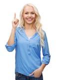 Mujer joven atractiva que destaca su finger Imagen de archivo