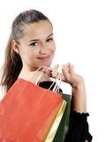 Mujer joven atractiva que hace compras foto de archivo