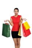 Mujer joven atractiva que hace compras fotos de archivo