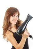 Mujer joven atractiva que lleva a cabo el hairdryer foto de archivo