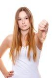 Mujer joven atractiva que muestra los pulgares abajo Imágenes de archivo libres de regalías
