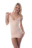 Mujer joven atractiva que presenta en Mini Dress apretado corto Imágenes de archivo libres de regalías