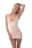 Mujer joven atractiva que presenta en Mini Dress apretado corto Imagenes de archivo
