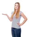 Mujer joven atractiva que señala a la cara Fotos de archivo libres de regalías