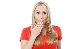 Mujer joven chocada sobre blanco Imágenes de archivo libres de regalías