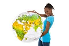 Mujer joven coloreada aislada que sostiene un globo en sus manos Imagenes de archivo
