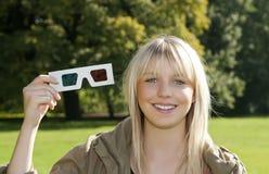 Mujer joven con 3D-glasses Imágenes de archivo libres de regalías