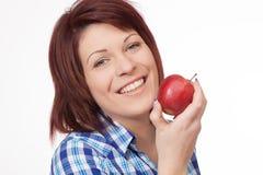 Mujer joven con Apple Fotografía de archivo