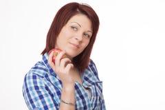 Mujer joven con Apple Imágenes de archivo libres de regalías
