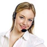 Mujer joven con auriculares del centro de llamada Fotos de archivo