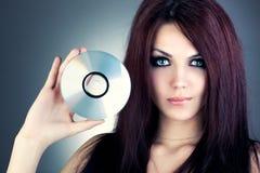 Mujer joven con CD Fotografía de archivo libre de regalías