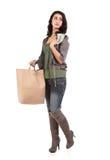 Mujer joven con compras y efectivo Foto de archivo