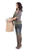 Mujer joven con compras y efectivo Imagen de archivo libre de regalías