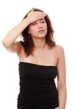 Mujer joven con dolor de cabeza Imagen de archivo libre de regalías
