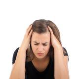 Mujer joven con dolor de cabeza Foto de archivo libre de regalías