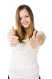 Mujer joven con dos pulgares para arriba Foto de archivo libre de regalías