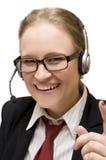 Mujer joven con el auricular Foto de archivo libre de regalías