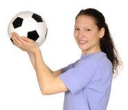 Mujer joven con el balón de fútbol Imagen de archivo libre de regalías