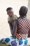 Mujer joven con el bebé Imagen de archivo