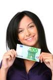 Mujer joven con el billete de banco euro Imagenes de archivo