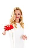 Mujer joven con el bolsillo vacío, en blanco Imágenes de archivo libres de regalías