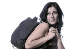 Mujer joven con el bolso en el Ba Foto de archivo
