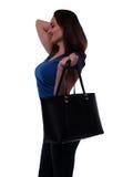 Mujer joven con el bolso negro Imagen de archivo