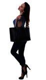Mujer joven con el bolso negro Imagenes de archivo