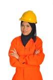 Mujer joven con el casco de seguridad fotografía de archivo