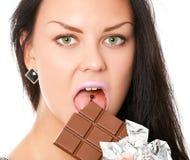 Mujer joven con el chocolate Imagenes de archivo