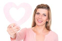 Mujer joven con el corazón Foto de archivo