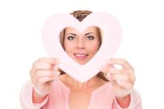 Mujer joven con el corazón Foto de archivo libre de regalías