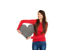 Mujer joven con el corazón hecho del papel Foto de archivo libre de regalías