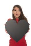 Mujer joven con el corazón hecho del papel Imagenes de archivo
