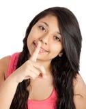 mujer joven con el dedo en sus labios Imagen de archivo libre de regalías