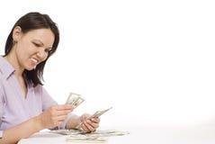 Mujer joven con el dinero Imagen de archivo