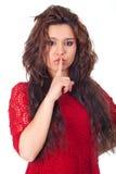 Mujer joven con el finger en los labios Imagenes de archivo